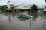 1983, Laguna Beach, California, USA --- Floods from the El Nino Storm of 1983, engulf a blue Volkswagen Bug, parked on a shopping street in Laguna Beach. California, USA. --- Image by © Vince Streano/CORBIS